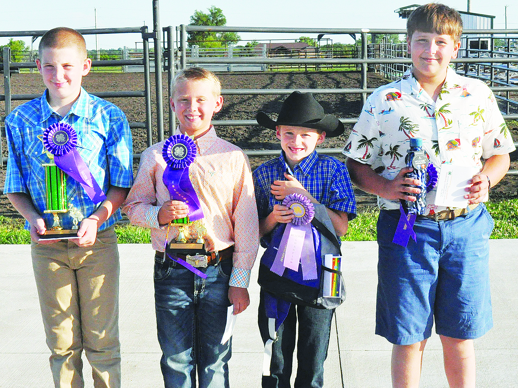 These 4-Hers took top honors in the boys buymanship competition at this year's fashion revue. Winners are shown above and include (from left) Zane Montgomery (intermediate champion), Grady Moss (junior champion), Colt Mattox (junior reserve champion) and Cole Kucan (senior champion). (Photo by Ali Holcomb)