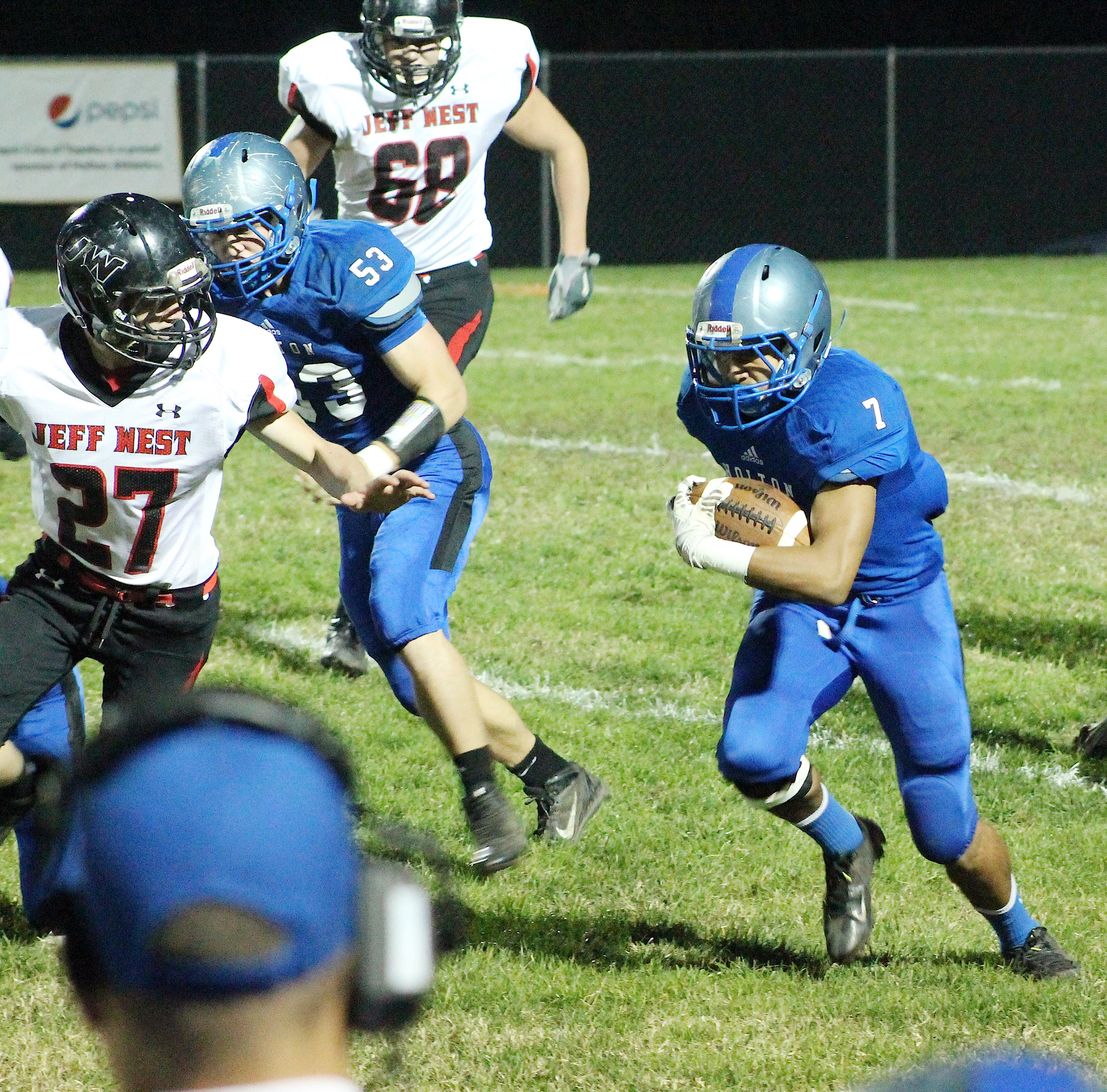 Wildcat Luis Butto (right) tries to break free for a long run early in the district contest against Jeff West.