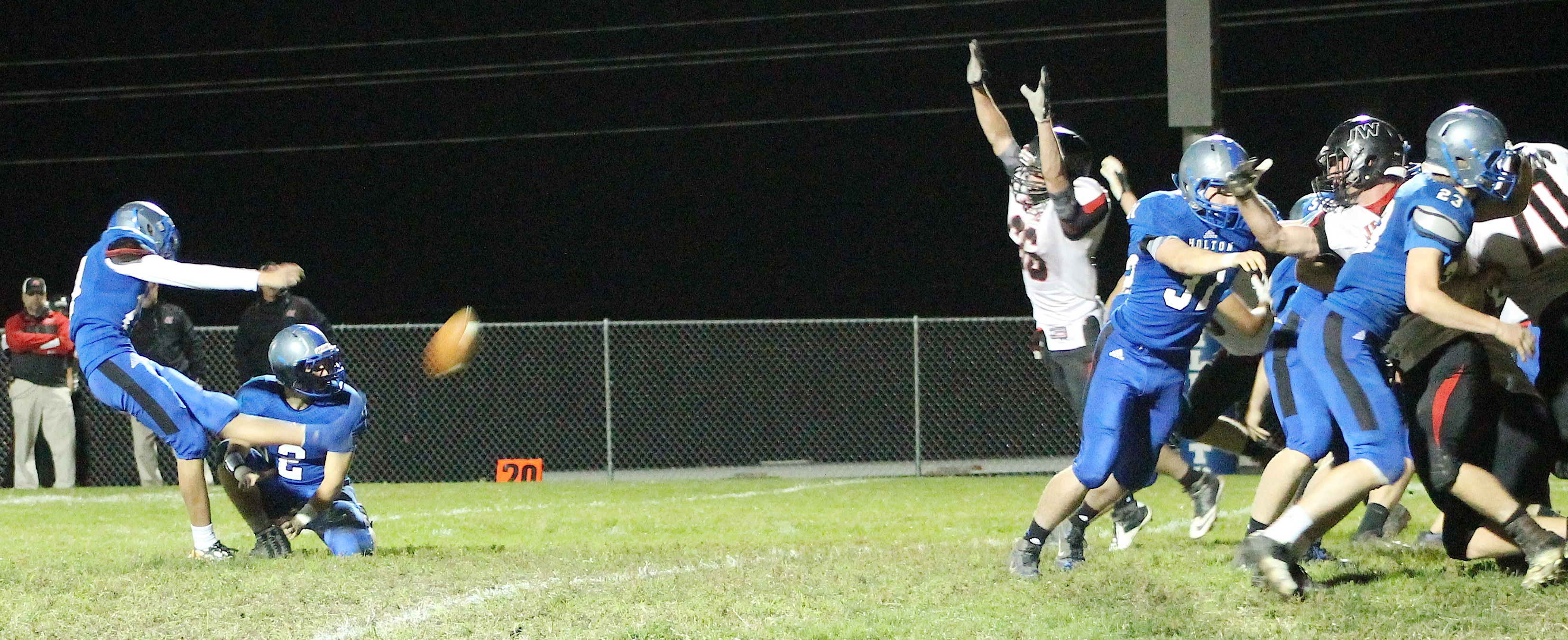 Kicker Arturo Reveles (left) boots a 22-yard field goal to put HHS up 24-6 going into halftime.