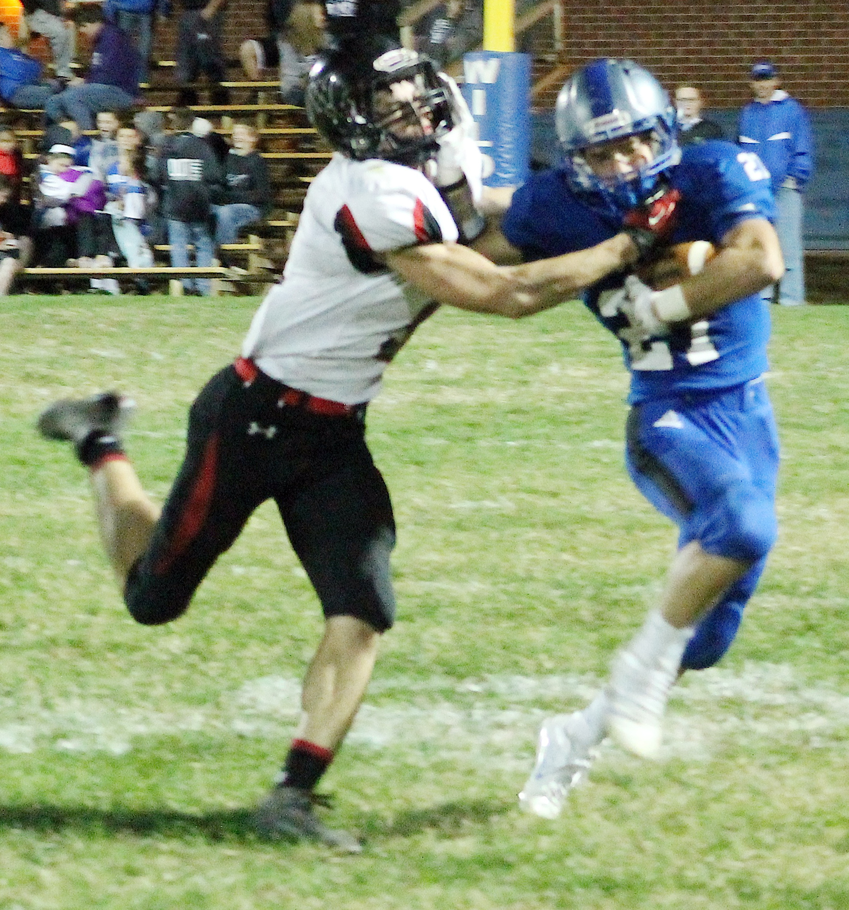 Running back Justin Pool (right) tries to stiff arm a Tiger defender late in the game against Jeff West as Holton works to run out the clock.