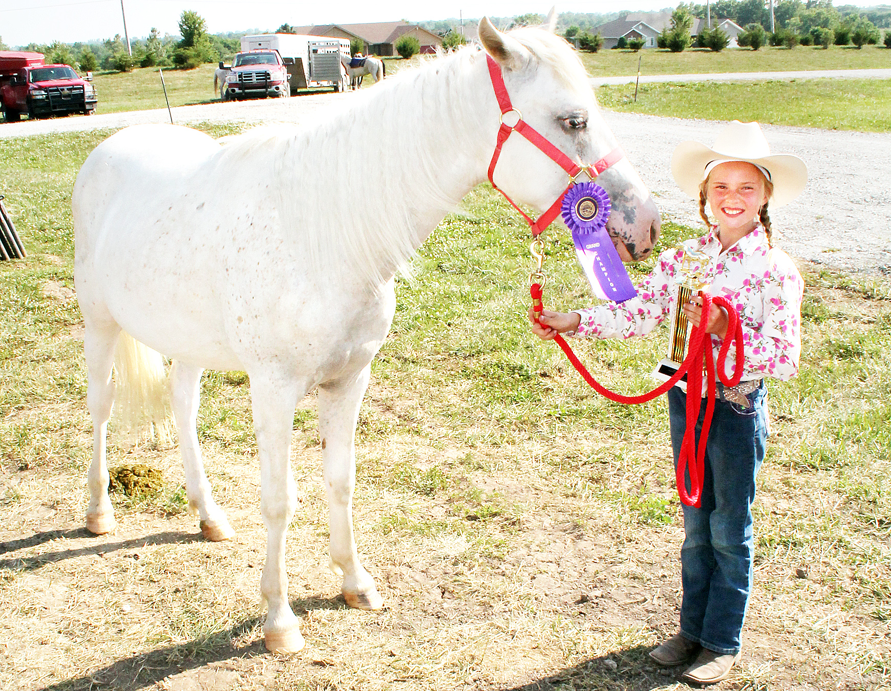 Miriam Halbleib of the Denison Builders won the showmanship, western pleasure and trail riding competitions for ages 7-9 at this year's horse show.