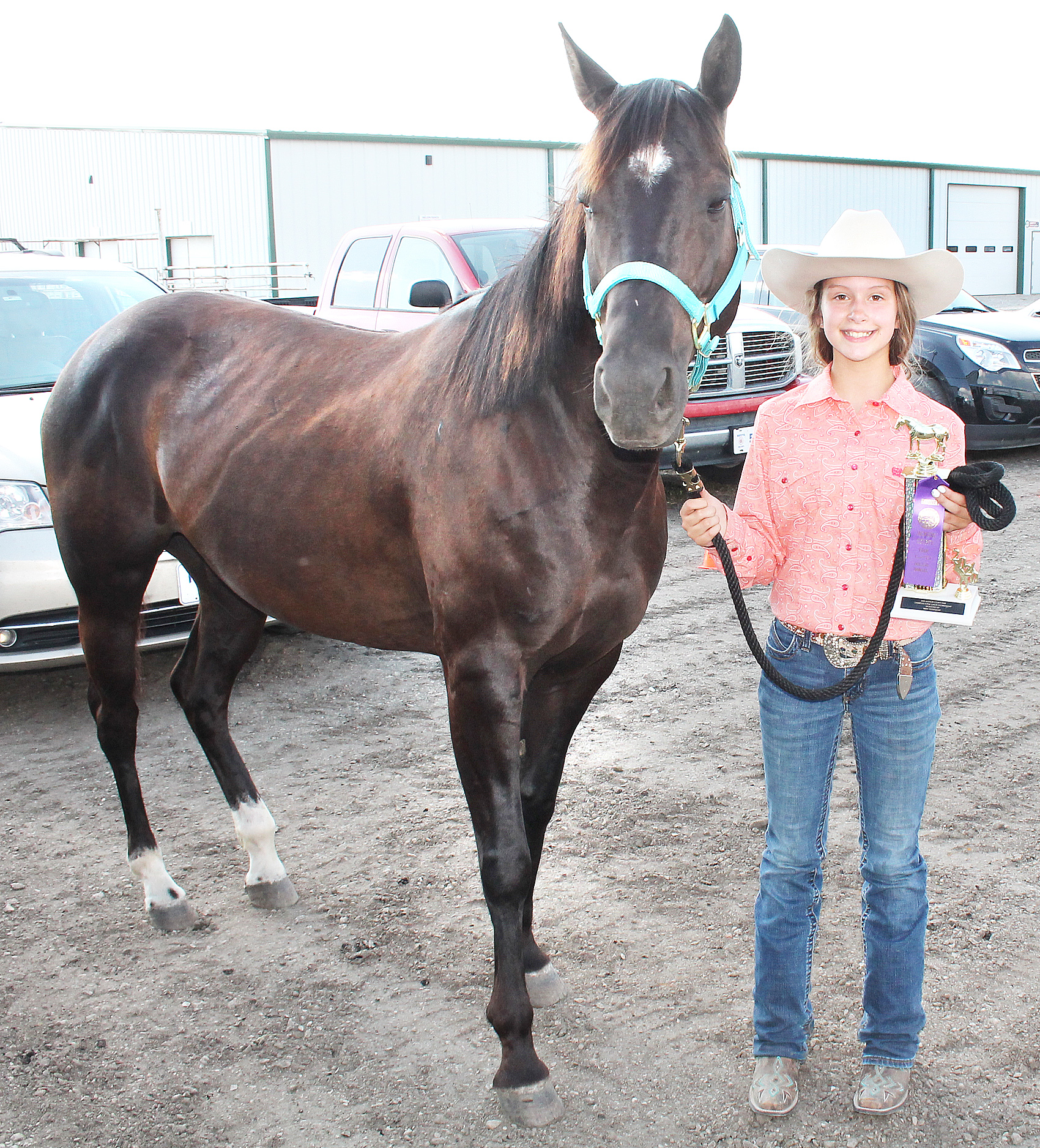 Presley Phillips, a member of the Denison Builders 4-H club, competed in events for ages 10-13 in this year's horse show, winning top honors in junior showmanship.