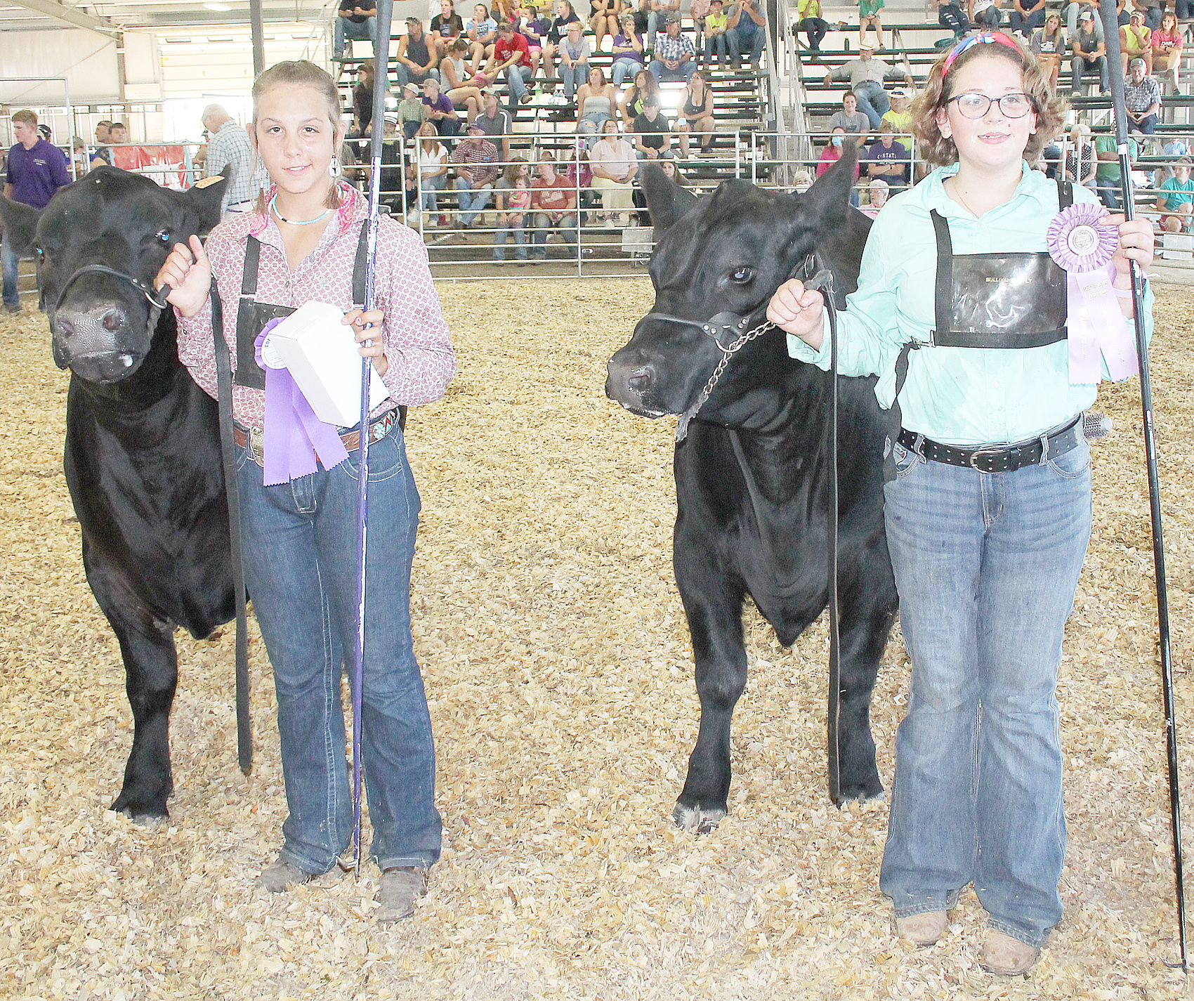 In intermediate beef showmanship, Savannah Cattrell (left) of the Soldier Boosters was named champion while Christan Kucan (right) of the Lucky Stars was named reserve champion.