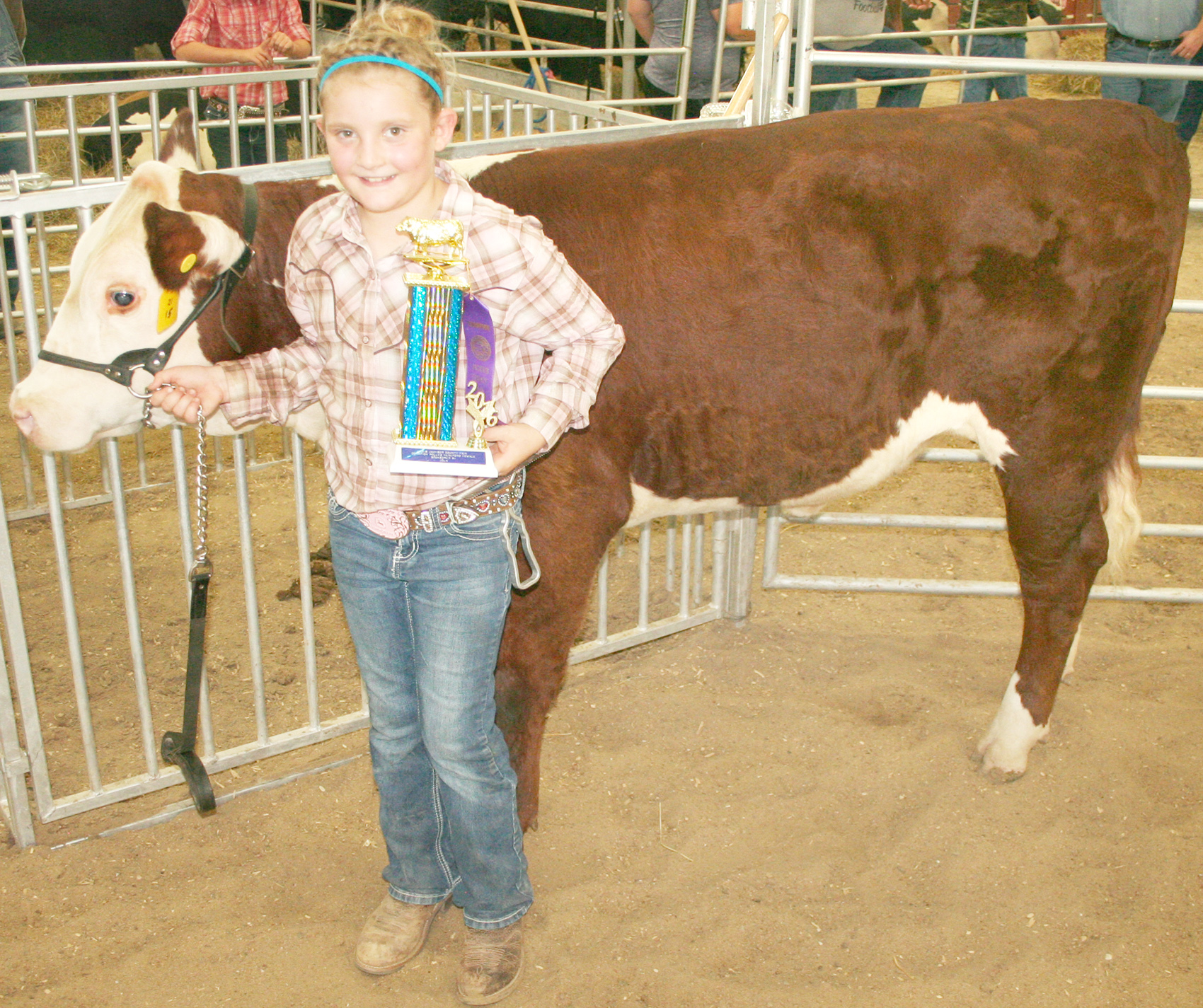 Jennifer Buck of the Soldier Boosters showed the top polled Hereford heifer at the beef show. (Photo by Brian Sanders)