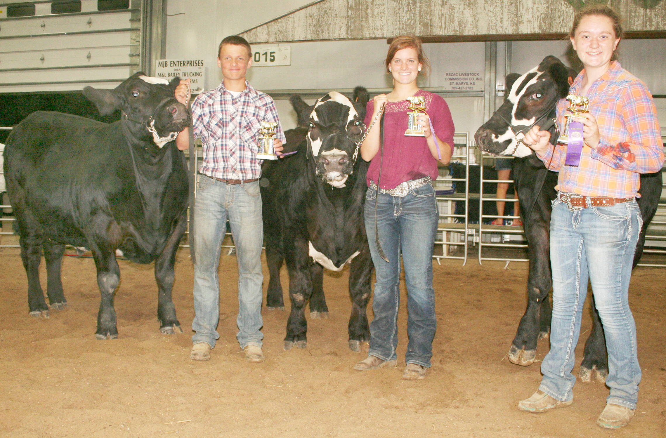 The top beef pen of three was shown by the North Jackson Jets, represented by (left to right) Colby Rethman, Olivia Yingst and Jenna McAllister. (Photo by Brian Sanders)