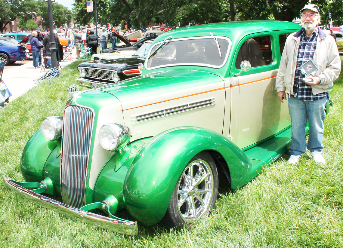 """Vince DiPasquale of Topeka and his 1935 Plymouth PJ, chosen as the winner of the """"Commissioners' Choice"""" award in the car show"""