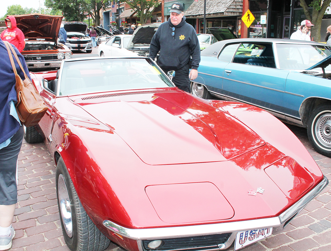 """Jackson County Sheriff Tim Morse inspects cars to make a pick for the """"Sheriff's Choice"""" award."""