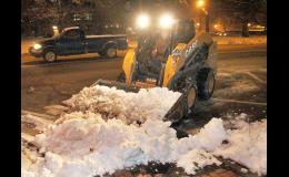 Holton Street Superintendent Greg Tanking was hard at work before the crack of dawn on Monday removing excess snow from parking areas along the south side of Holton's Town Square. Tanking and his crew are getting ready to remove more snow and other precipitation due to winter weather that is expected to make its way into the area on Friday. (Photo by Brian Sanders)