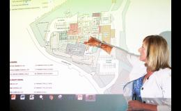 Holton Community Hospital CEO Carrie Saia showed a proposed floor plan for expansion at the hospital to a crowd of about 50 at The Hot Spot on Wednesday evening. Hospital officials are seeking a $16.5-million USDA Rural Development loan for the proposed expansion. (Photo by Brian Sanders)