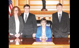 """Jackson Heights High School student Ed Mandala (second from left) and Holton High School student Aaran McAllister (right) recently met with Kansas Gov. Laura Kelly (seated) to discuss the """"Safe 75 Initiative,"""" a student-led effort to encourage safety improvements along U.S. Highway 75 between Holton and the Kansas-Nebraska state line. With the students is JHHS Student Council adviser Katie Morris. (Submitted photo)"""