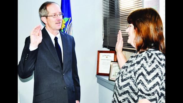 Jackson County Clerk Kathy Mick (right) swore in Rob Ladner as the Jackson County Commissioner for District One on Monday in the commissioners' chamber at the Courthouse. Ladner began his four-year term that afternoon.