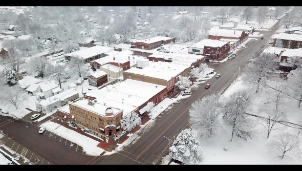 A winter storm that passed through the area late Friday and early Saturday dumped about four to six inches of snow on Holton, transforming the Town Square — the south side of which is shown here — into a winter wonderland. (Photo courtesy of Troy Moppin)