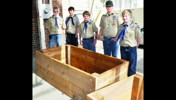 Members of Holton Boy Scout Troop 64 assembled frames for raised garden beds Monday during a reception for the new Prairie View Senior Residences in Holton. The frames will be installed at the new affordable apartments for area seniors. Scouts involved in the project included (shown from left) Trevor Klahr, Caden Huskey, Kyle Figge, Ralph Ortega and Garrett Klahr. The troop leader is Craig Figge.