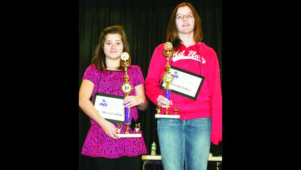 Alyssa Carlisle (left), a sixth-grade student at Royal Valley Middle School, won the Jackson County Spelling Bee on Saturday, while Kassidy Fisher (right), a sixth-grade student at Holton Middle School, took second place in the bee. Both will go to the regional spelling bee on Saturday, March 7 at Seaman High School in Topeka.