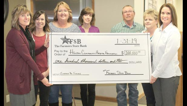 Holton Community Hospital CEO Carrie Saia accepted the donation of $100,000 from The Farmers State Bank to go toward the hospital's expansion project, presented by FSB President and CEO Tonya Barta this past Thursday. Shown from left to right are Saia; Leslie Smith, bank board secretary; Judy May, bank vice president; Susan Pfrang, bank board member; Gary Pfrang, bank board chairman; Terri Young, bank vice president; and Barta. (Photo by Brian Sanders)