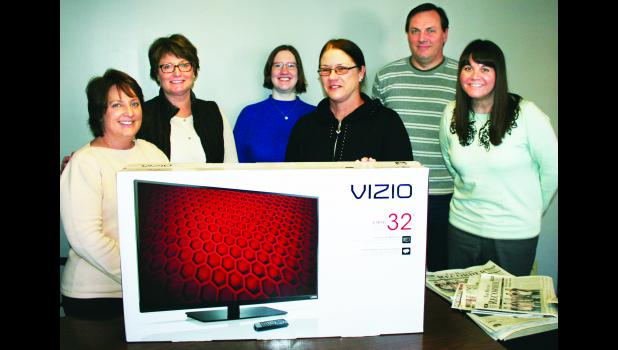 Susie Jacobs of Muscotah (third from right) won a 32-inch TV as part of The Holton Recorder's annual Super Pick'em Contest by correctly guessing that the New England Patriots would win the Super Bowl 28-24. Jacob's submitted her winning entry at Koger Variety. Pictured with Jacobs are Recorder staff members (from left) Shannon Schmille, Connie Powls, Kendra McClain, Brian Sanders and Ali Holcomb.