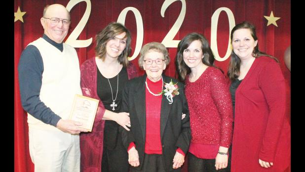 The Holton/Jackson County Chamber of Commerce's 2020 Hall of Fame banquet, held this past Wednesday at the EUM Family Life Center, saw four Jackson County women honored for their contributions to the community, including Floye Knouft (center), who was joined by son Mark Knouft (left) and granddaughters (from left to right) Lindsay Alley, Carly Fletcher and Tara Ladusch. (Photo by Brian Sanders)