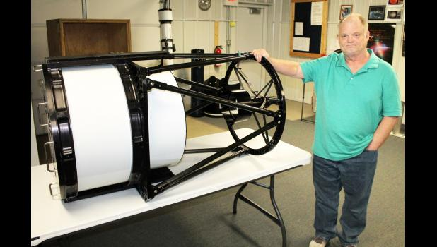 Banner Creek Science Center and Observatory Mike Ford is seen here with the 20-inch telescope that will soon be replaced with a 24-inch telescope. The 20-inch scope has been in use at the science center and its predecessor, Elk Creek Observatory, for nearly 15 years. (Photo by Brian Sanders)