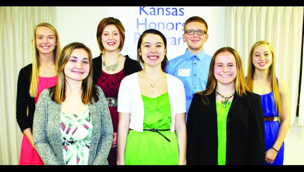 Seven Royal Valley High School seniors were honored, including, front row, from left: Leanna Just, Brooke Slayton and MaRyka Smith; back row, from left: Hannah Beam, Kassidy Dahl, Brandon Broxterman and Leslie Schuetz.