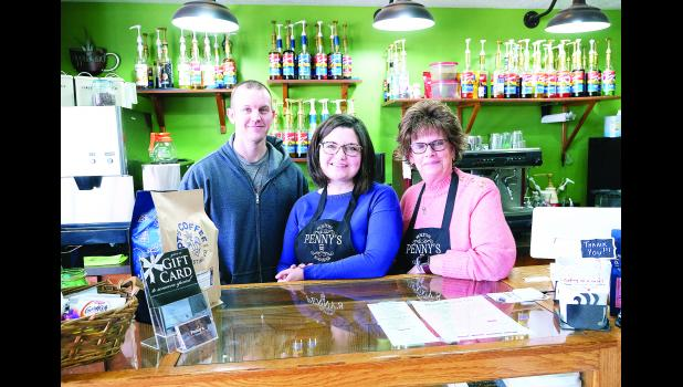 Travis and Brittany DeBarge (shown at left) have purchased Penny's on the west side of the Holton Square. Sally DeBarge (shown at right) is managing the shop.