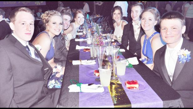 After arriving at the Jackson Heights High School prom on Saturday evening, Cobra students and their dates were treated to dinner during the Mardi Gras-themed event. Those pictured include (front, from left) Austin Shepley, Maggie Rostetter, Izaac Pritchett, Hannah Williams, Alexis Rieschick, Ethan Fund, Erika White and Kolby Rethman. (Photo by Ali Holcomb)