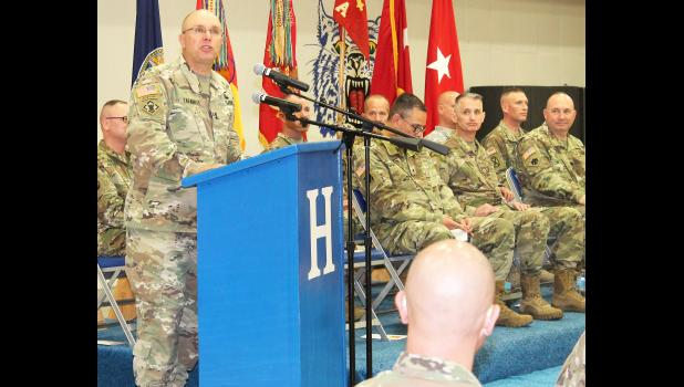Kansas Adjutant General Lee Tafanelli (left) addressed the 120 men and women of Battery A, 2nd Battalion of the 130th Field Artillery Regiment of the Kansas National Guard during a deployment ceremony on Friday in the Holton High School gym. (Photo by Brian Sanders)