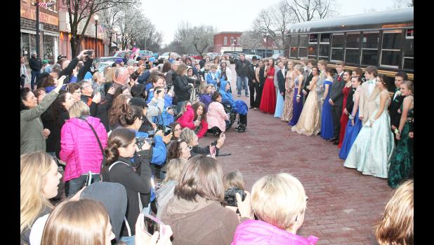 The formal dresses and suits - and the cameras - were out in force Saturday evening on the west side of Holton's Town Square, where Holton High School students and their dates were arriving at Penny's for the annual HHS prom. (Photo by Brian Sanders)