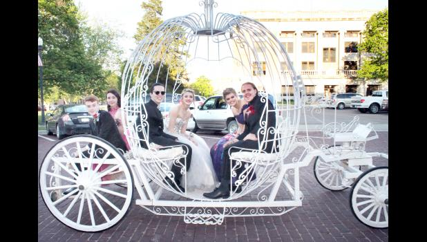 HHS students and their dates traveled to the prom in a specially rented carriage, including, from left to right, Brody Harshaw, Taylor Stevens, Joshua Chavez, Makayla Colhouer, Brandon Lehnherr and Kendall Raney.
