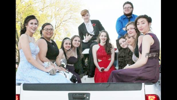 A group of HHS students and their dates rode to the prom in the back of a pickup truck. From left to right are Lauren Leavendusky, Kaylee Davis, Marrissa Petersen, April Utterback, Skyler Weir, Starla Weir, Maryanne Gorden, Trevor Krogman, Cecilia Ventura-Vasquez, Alison Marriott and Berenice Alvarez.