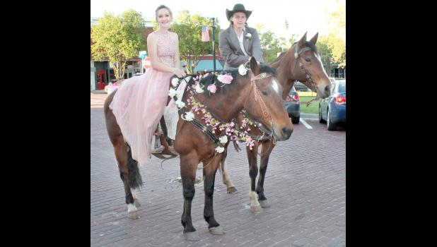 Different modes of transportation were used in getting Holton High School students and their dates to the prom, held Saturday evening at Penny's on the Square. Here, Sophia Mellenbruch (left) and Wyatt Graber arrived on horseback.