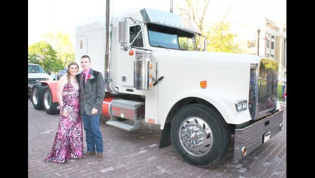 """Ashley Nioce (left) and Jacob Gillie arrived at the Holton High School prom at Penny's on the Square on Saturday in this semitrailer, one of several different modes of transportation used by HHS students and their dates in """"truckin'"""" to the prom."""
