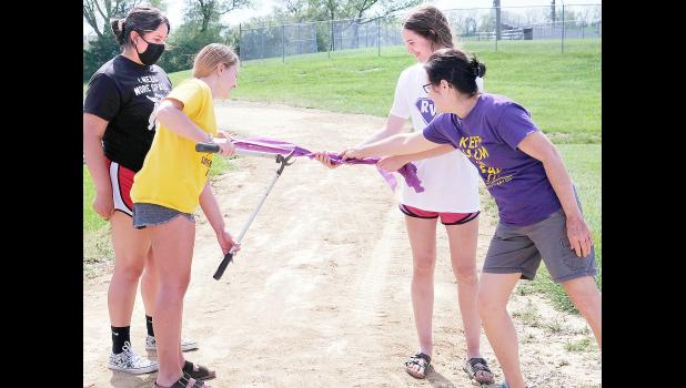 Members of the Royal Valley High School KAY Club hosted a ribbon-cutting ceremony to mark the official opening of the new walking and nature trail behind RVHS. KAY Club members shown include (from left) Alyssa Levier, Lilly Rooks and Kennedy Bryan, along with Brenda Lambrecht, KAY sponsor. (Photo by Ali Holcomb)