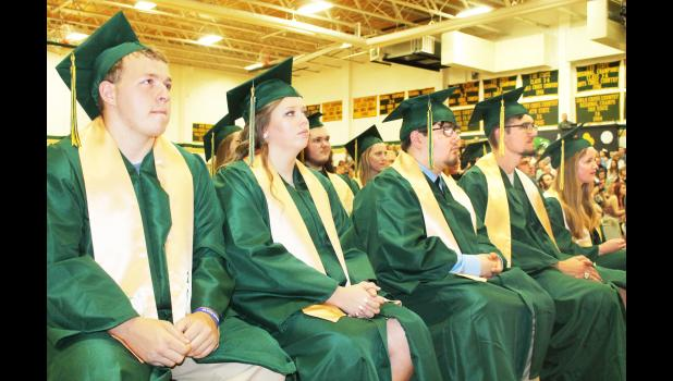 Graduating Jackson Heights seniors (from left to right) Dawson Boell, Grace Bowhay, Charlie Burks, Dalton Chartier and Hanna Davault listen to the valedictory remarks of classmate Braden Dohl during JHHS commencement ceremonies on Sunday. (Photo by Brian Sanders)