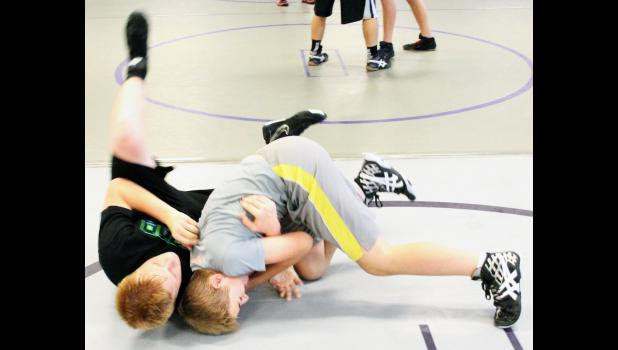 Royal Valley High School's Karsen Smith (shown above, left) and Washburn Rural High School's Dominic Holthaus (right) hit the mat during practice at the fourth-annual Royal Valley Medalist Wrestling Camp.
