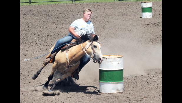 The first big event of the 2019 Jackson County Fair — the horse show — was held this past Sunday at the Northeast Kansas Heritage Complex outdoor arena, where Dakota Abel of the Soldier Boosters 4-H club guided his horse around the barrels in the timed events, winning the barrel race for competitors aged 14-18. (Photo by Brian Sanders)