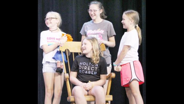 "Holton Community Theatre will stage ""Annie"" this Saturday and Sunday at the Holton High School auditorium, which features (from left) Zoey Tinney, Beka Lassey (seated), Heather Mandala and Amanda Taylor. The musical is one of several activities available to area residents this weekend. (Photo by Ali Holcomb)"