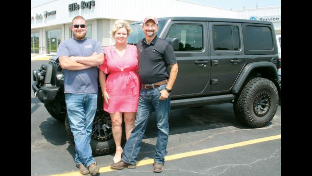 David Ellis of Ellis Boys Chrysler Dodge Jeep Ram in Holton is shown at right with wife Elise (center) and son Adam. (Photo by Brian Sanders)
