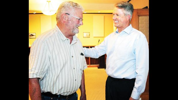 """U.S. Sen. Roger Marshall (shown at right) chatted with Holton businessman Dan Harris prior to the start of the senator's recent """"town hall"""" meeting at the Jackson County Courthouse. (Photo by Brian Sanders)"""