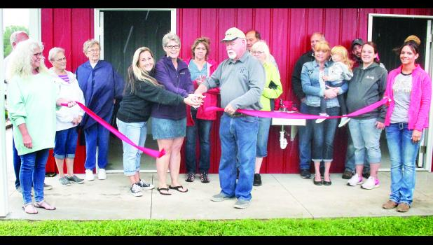 Holton Mayor Robert Dieckmann (center) cut the ceremonial ribbon on the new Dogwood Dog Park facility on Saturday in spite of rain falling all around. (Photo by Brian Sanders)