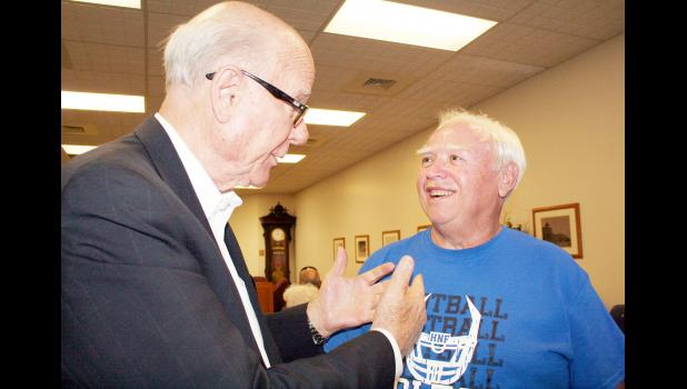 U.S. Senator and 1954 Holton High School graduate Pat Roberts (left) talked with his fellow HHS graduate and former Kansas State University roommate L.D. Fletcher prior to Roberts' town hall meeting on Thursday at Holton City Hall. (Photo by Brian Sanders)