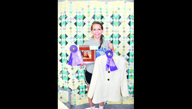Danica Haverkamp of the Denison Builders 4-H Club received the Best of Show award at the Kansas State Fair in Hutchinson for this teal, yellow and black quilt she constructed. The photo above was taken during July's Jackson County Fair where Haverkamp also earned honors in needle art and clothing construction.