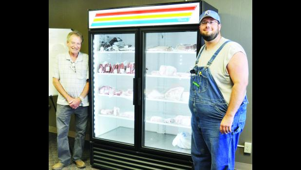 Heartland Meat Market opened recently in downtown Holton, offering a wide selection of meats. Shown in the above photo are employee Billy McCauley (left) and owner David Tinney (right). Tinney owns the business with Matt McCauley.
