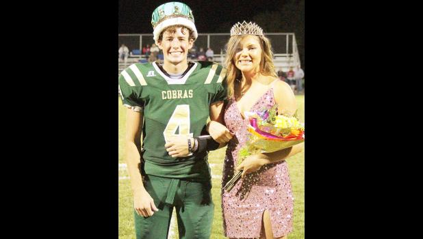 Jackson Heights High School seniors Silas Holliday (shown above at left) and Kylee Dieckmann were named the school's football homecoming king and queen at halftime of Friday's game against Alma-Wabaunsee. (Photo by Michael Powls)