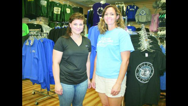 Long-time Lasting Impressions employees Stephanie Riley (left) and Michelle Callison (right) are now the new owners of the Holton custom embroidery, screen printing and vinyl graphics business, having taken over from previous owner Carole Danner in recent days.