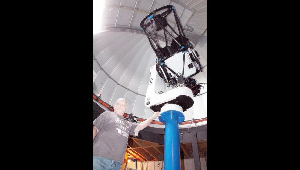 Banner Creek Science Center and Observatory director Mike Ford is shown with a new 24-inch PlaneWave telescope that was recently installed at the science center. Find out more in the Monday, Oct. 8 Recorder. (Photo by Brian Sanders)