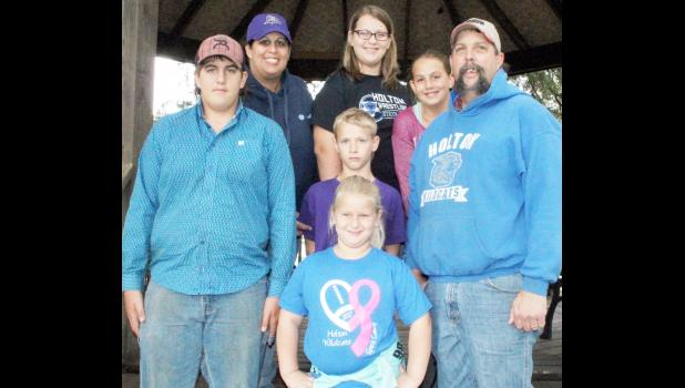 For the family of Carmen and Danny Cattrell, 4-H is an extended family affair, involving not only their children, but also the children's cousins. All of them are involved in the Soldier Boosters 4-H club. Front row: Kennedy Tannahill; second row, from left: Kaden Cattrell, Koy Tannahill and Danny Cattrell; back row, from left: Carmen Cattrell, Karoline Tannahill and Savannah Cattrell. October is 4-H Month. (Photo by Brian Sanders)