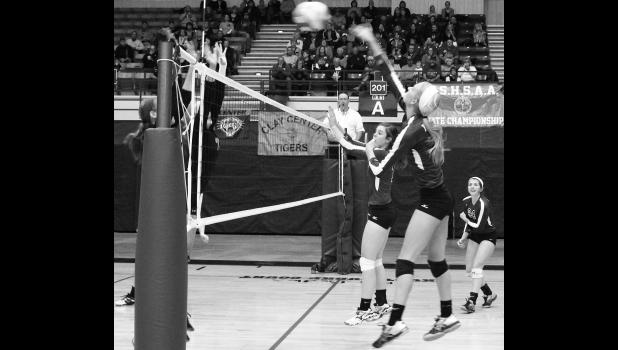 Royal Valley's Hannah Beam (shown above, right) slams an attack over the net during state semifinal action against Clay Center on Saturday.