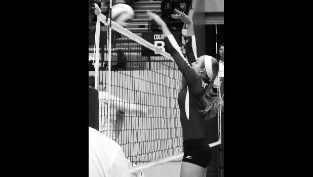 RVHS hitter Sarah Beam (shown above, right) blocks a ball back over the net during pool play at the state tournament. When the Panthers got their block working, the team turned things around and was able to qualify for the second day of state competition.
