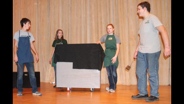 "From left to right, Jackson Heights High School students Drew Holliday, Kate Lierz, Kassidi Strathman and Hunter Sturgeon act out a scene from ""Crumpled Classics,"" in which the Romeo and Juliet story plays out over a proposed fast-food merger. (Photo by Brian Sanders)"