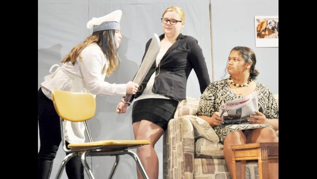 "Royal Valley High School will present ""Hotel Nashville"" on Friday and Saturday at the elementary school gym in Hoyt. In this scene, Greta, a knife-wielding chef played by Hanna Allen (left), accuses Mary, played by Noah Spencher (center), and Mary's grandmother, played by Gabi Simmons (right), of stealing one of her kitchen knives. (Photo by Ali Holcomb)"